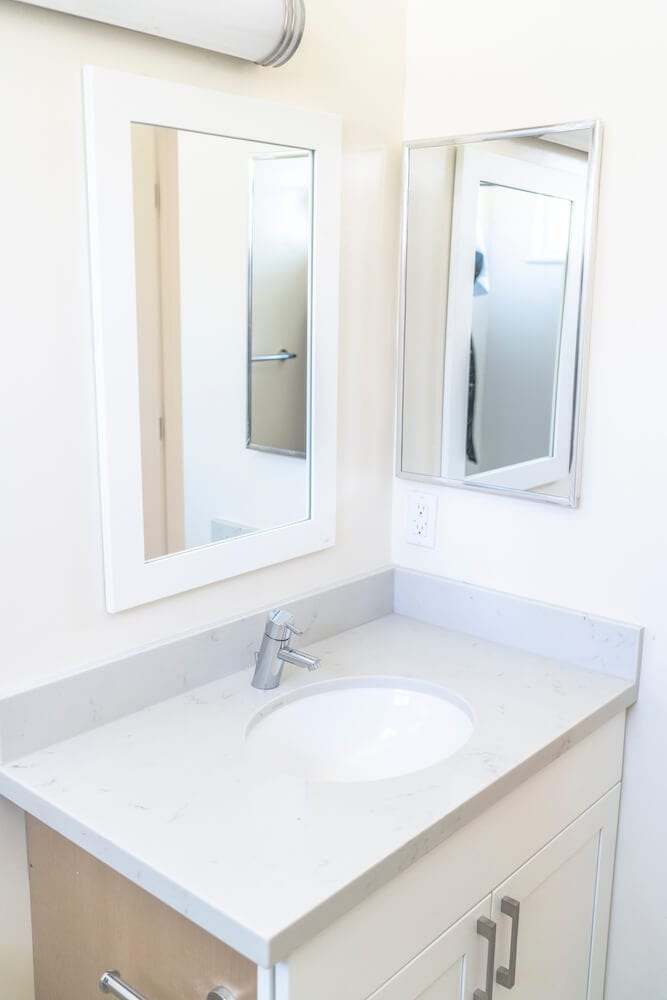 Mirror and white bathroom sink from LA Intern student housing